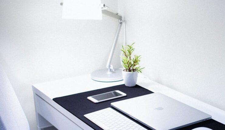 photo of macbook pro near iphone and apple magic keyboard